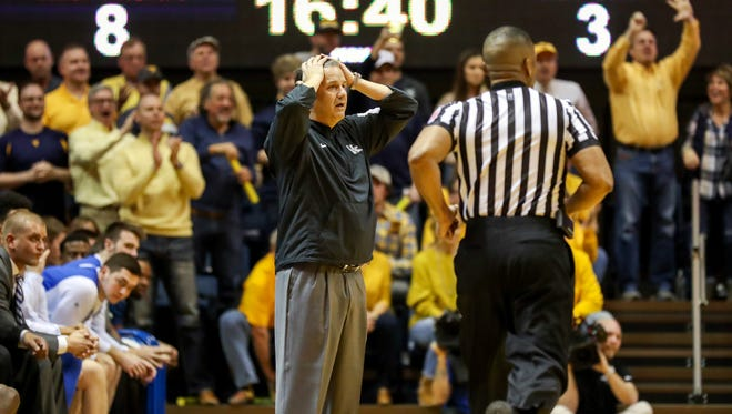 Kentucky Wildcats head coach John Calipari reacts after a call during the first half against the West Virginia Mountaineers at WVU Coliseum in Morgantown, West Virginia, on Saturday, Jan. 27, 2018.