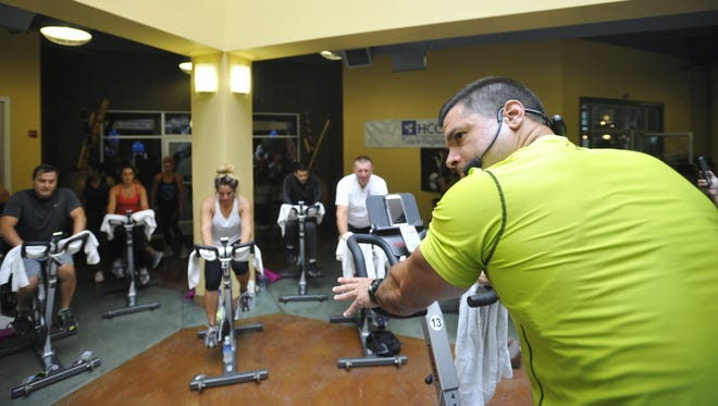 Evolutions spinning instructor Matt Villanueva get the class pumped up during the first annual Spin-A-Thon.