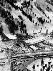 A crowd estimated at 35,000 jams the athletic complex on the floor of Squaw Valley, Calif. on Feb. 21, 1960 during Winter Olympics program. Most of them are gathered around the foot of the 60-meter ski jump hill where the first half of the Nordic combined competition is underway. At right is the Ice Arena where a hockey game is in progress and in front of it the speed skating rink.