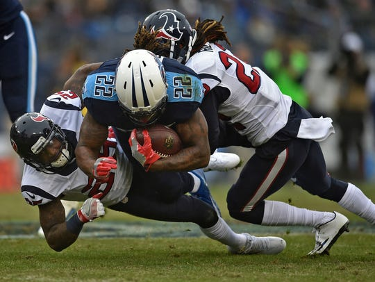 Titans running back Derrick Henry (22) is tackled in
