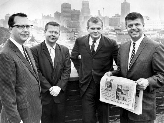 Angus McEachran, second from right, is pictured in July 1966 after being named assistant city editor of The Commercial Appeal. With him are, from left,  James Killpatrick, Kyle Griffin and Granville Allison Jr. McEachran died Monday.