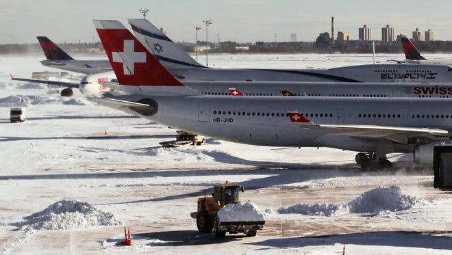 Heavy equipment clears snow from the tarmac at JFK International Airport on Dec. 27, 2010.