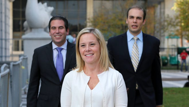 Gov. Chris Christie's former Deputy Chief of Staff Bridget Anne Kelly, center, leaves Martin Luther King Jr. Courthouse after a hearing, Wednesday, Oct. 19, 2016, in Newark, N.J. Three years after gridlock paralyzed a New Jersey town next to the George Washington Bridge for days, two former allies of New Jersey Gov. Chris Christie, Kelly and Bill Baroni, Christie's former top appointee at the Port Authority of New York and New Jersey, are being tried on charges of politically motivated lane closures of the George Washington Bridge in 2013.