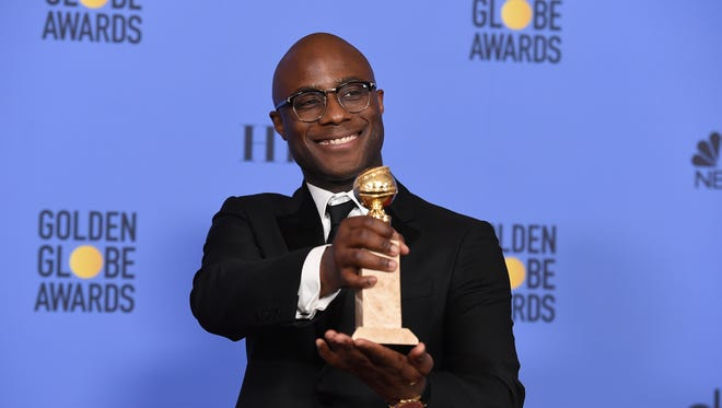 "Barry Jenkins poses in press room with the award for Best Motion Picture - Drama for ""Moonlight"" at the 74th annual Golden Globe Awards."