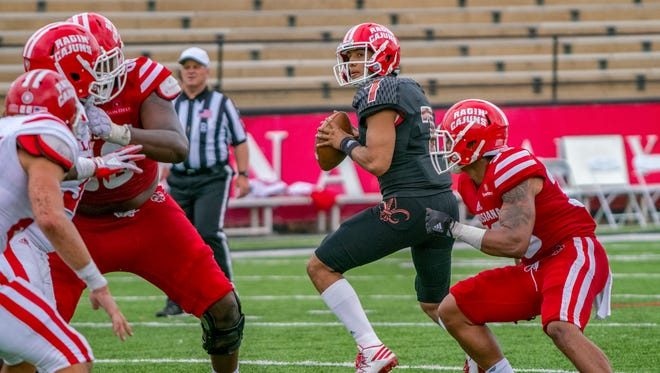 Fifth-year senior Andre Nunez, shown here in UL's spring game earlier this year, has been battling sophomore Levi Lewis for the Ragin' Cajuns' No. 1 quarterback job.
