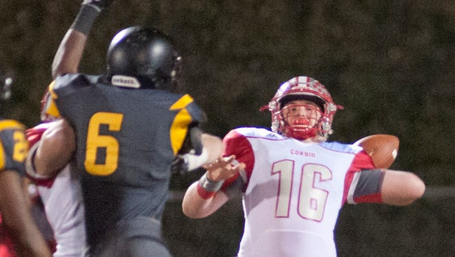 Corbin quarterback Camron Sizemore prepares to throw as Central defensive end Trey Williams tries to block in the Class 3A state semifinals at Central.  Nov. 24, 2017