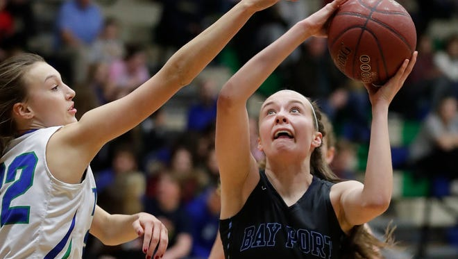 Notre Dame against Bay Port High School's Mady Draak tries for a put back against Sammy Opichka at Notre Dame Academy Tuesday, February 13, 2018 in Green Bay, Wis.