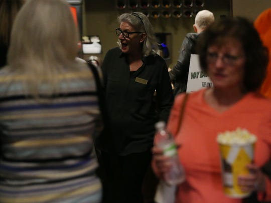 Marianne Fons, of Winterset, greets movie-goers on