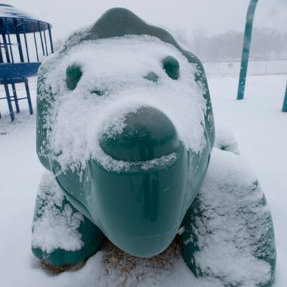 Snow settles on jungle gym equipment at Chambersburg
