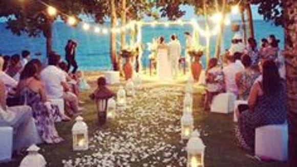 Lanterns light up a beautiful ceremony after the sun goes down.