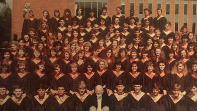 Gary Frame, lower center, poses with the Sprague Concert Choir at the Best in the Northwest Choir Festival in 1989. Frame taught in the Salem-Keizer School District from 1963 to 1994 and set the bar for musical excellence in the district.