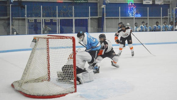 Suffern forward Kyle Foresta is stopped by Mamaroneck