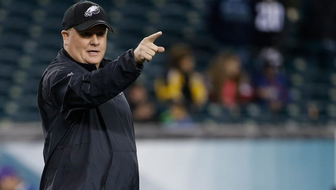 Philadelphia Eagles head coach Chip Kelly gestures during warm-ups before the team's Dec. 20 game against the Arizona Cardinals. Kelly and the Eagles parted ways on Tuesday night.