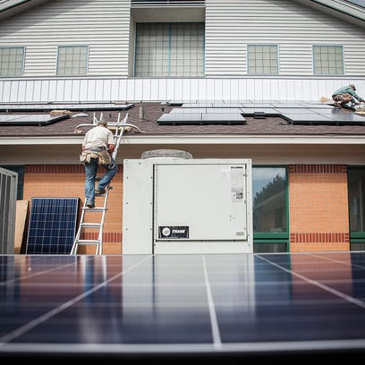 Workers with Indianapolis based company Rectify Solar