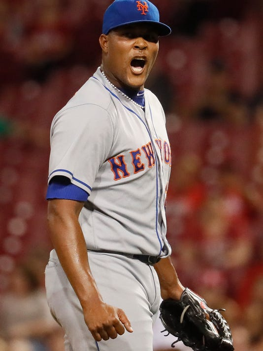 New York Mets relief pitcher Jeurys Familia reacts after closing the ninth inning of a baseball game against the Cincinnati Reds, Tuesday, Sept. 6, 2016, in Cincinnati. The Mets won 5-3. (AP Photo/John Minchillo)