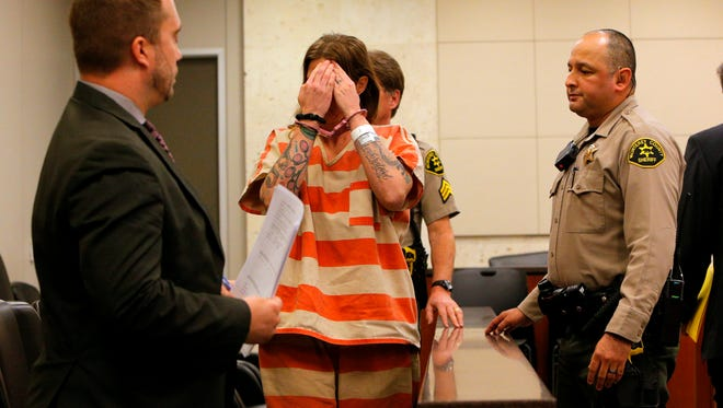 Tami Huntsman covers her face while leaving the courtroom on Friday