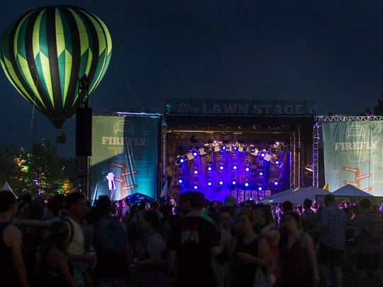 A hot-air balloon rises behind the Lawn Stage at Firefly.