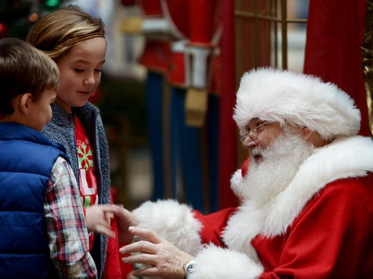 Karson and MaLea Kail greet Santa at Old Hickory Mall on Wednesday morning before taking photos with him. Photos with Santa continue through 6 p.m. Thursday.