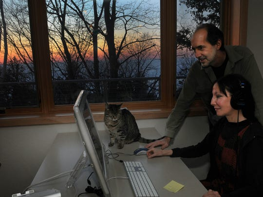"""Tim and Holly Erskine view their film """"The Emissary'' inside their Sister Bay post-production studio. Tim wrote and directed the sci-fi movie and Holly is a co-producer of the film, which makes its world premiere Friday at Door Community Auditorium."""