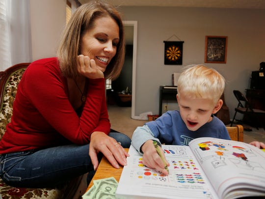 Cara Putman works with her son Daniel, 4, on math Monday, November 24, 2014, in their Lafayette home. An upstair room serves as the homeschooling classroom for all four of Putman's children. She, too, was homeschooled as a child growing up in Nebraska.