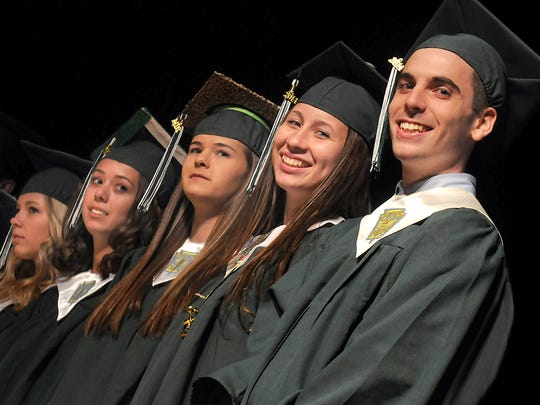 Spackenkill High School graduates, from right, Thomas Shaffer and Aislinn Speranza are all smiles during commencement Saturday evening at the Mid-Hudson Civic Center in Poughkeepsie.