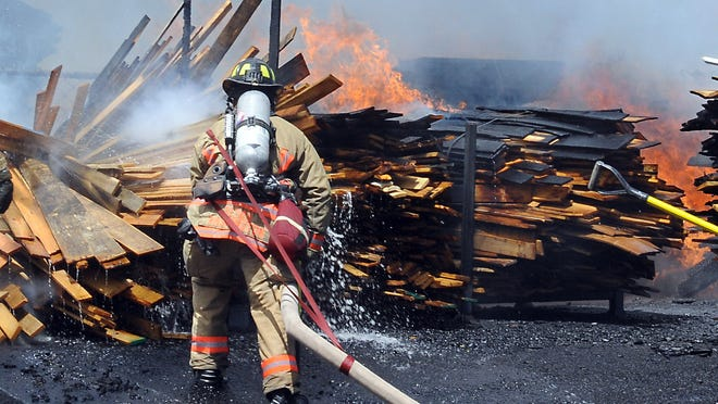 A Reno firefighter sprays a pallet fire on Bravo Avenue in Stead in May. Just 4 percent of the calls to the Reno Fire Department in 2013 were for fires; 70 percent were for medical emergencies.