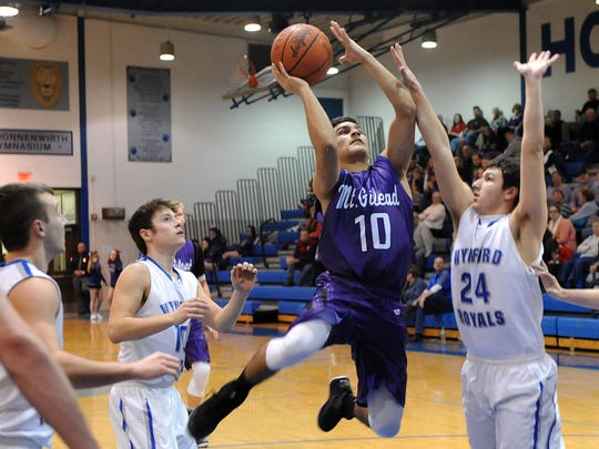 Deondre' Cook floats toward the basket for Mt. Gilead