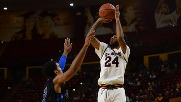 Nov 29, 2015: Arizona State Sun Devils guard Andre Spight (24) shoots over UC Santa Barbara Gauchos guard Gabe Vincent (2) during the second half at Wells-Fargo Arena. The Sun Devils won 70-68.