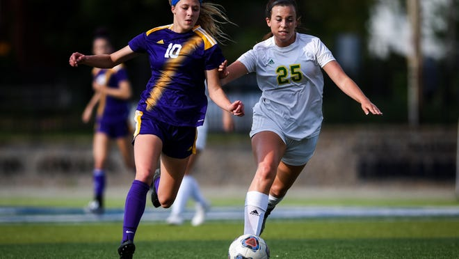 Hickman's Hannah Larson (10) dribbles the ball during a 2019 game against Rock Bridge at Columbia College.