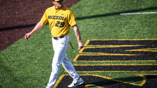 Missouri head baseball coach Steve Bieser walks back to the dugout after speaking with an umpire during a game in 2019 at Taylor Stadium.