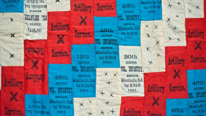 """Detail of a reunion ribbon quilt, top, from 1881 made for Elijah Henry Clay Cavins, a Union soldier from Indiana on display at """"Homefront & Battlefield: Quilts & Context in the Civil War"""" at the Shelburne Museum in Shelburne on Sept. 26."""