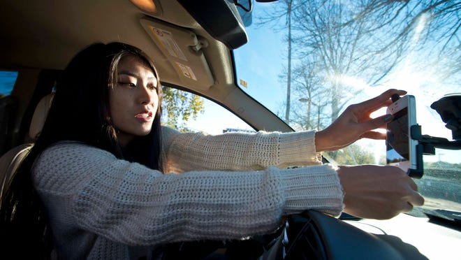 Nadia Borysyk, a student at the University of Vermont, is a driver for the Internet-based car service Uber in Burlington. Uber uses an app to connect clients with drivers using their personal vehicles.