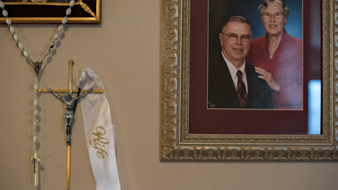 A portrait of Henry Rayhons and his late second wife, Donna Young, hangs in the living room of Rayhon's condo in Garner.