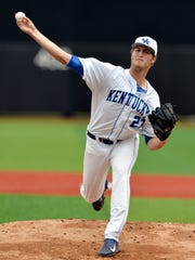 Kentucky's Kyle Cody pitches to Kansas in the top of the first inning during an NCAA college baseball regional tournament game in Louisville, Ky., Friday, May 30, 2014. (AP Photo/Timothy D. Easley)