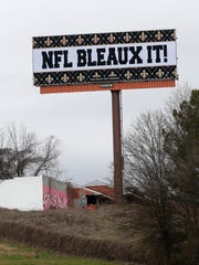 A billboard protesting a controversial call in the Sunday's NFL football game between the New Orleans Saints and Los Angeles Rams is shown along Interstate 75 near Hartsfield Jackson Atlanta International Airport in Atlanta Tuesday, Jan. 22, 2019.