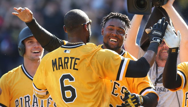 The Pittsburgh Pirates' Starling Marte celebrates with Alen Hanson after Marte hit a two-run game-winning home run against the Atlanta Braves.