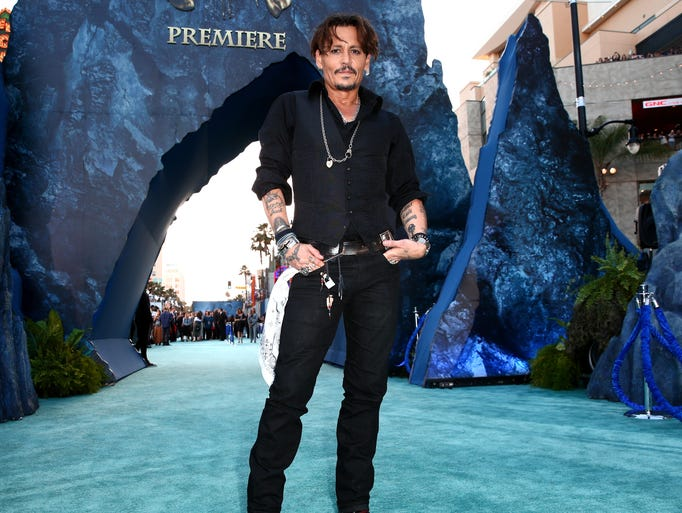 "Johnny Depp attends the premiere of Disney's ""Pirates"