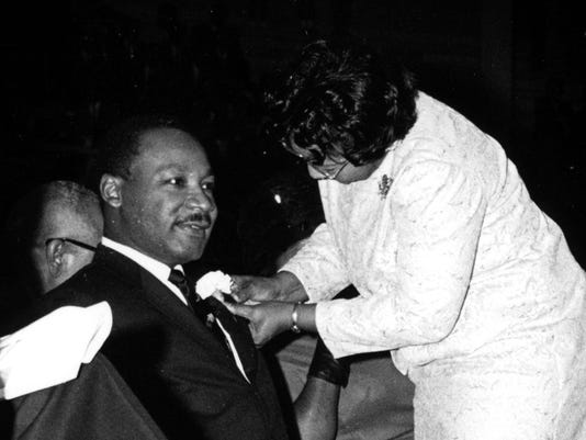 Title: MLK jr pinned with corsage, Coliseum, 8/2/66