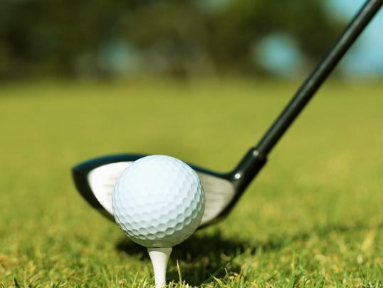 Side view of driver and golf ball on a tee