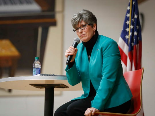 Sen. Joni Ernst, R-Iowa, speaks with constituents during her 99-county tour stop Monday, Jan. 15, 2018, at Boone High School in Boone, Iowa.