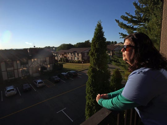 Maryann Boyd watches the sunset on the balcony of her condo in Valley Cottage.