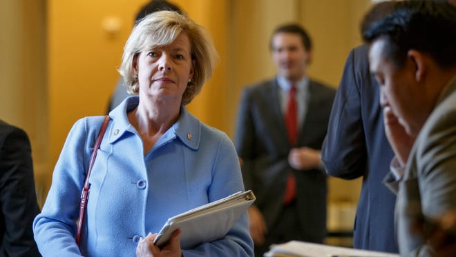 In this Nov. 18, 2014, file photo, Wisconsin Democratic Sen. Tammy Baldwin leaves a strategy session on Capitol Hill.