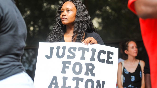 Community members gather on the steps of Baton Rouge City Hall to protest the death of Alton Sterling. July 6, 2016.