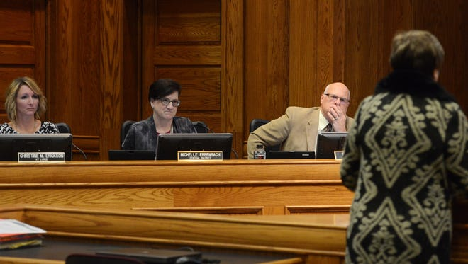 Sioux Falls city councilors, Christine Erickson, Michelle Erpenbach and Rex Rolfing listen as a citizen speaks during the public input portion of a council meeting Tuesday, Feb 9, 2016.