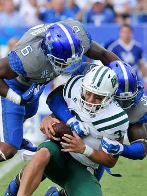 UK's Jason Hatcher (6) and Ryan Flannigan (33) sack Ohio quarterback J.D. Sprague in the second half, Saturday, Sept. 06, 2014, at Commonwealth Stadium in Lexington.