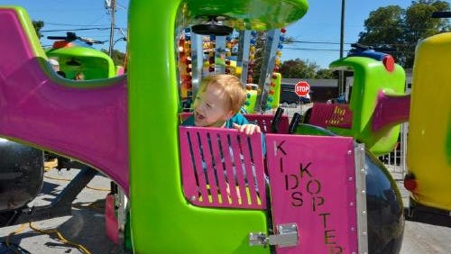 A child enjoys a ride at the 2014 Aunt Het Festival in Fountain Inn. This year's festival is set for Oct. 3.
