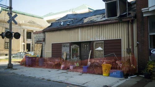 The 229 Carlisle St. residence that sustained damage in an August fire is photographed on Oct. 26.