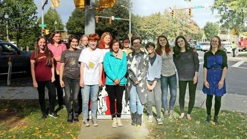 Brighton High School art students transformed two Brighton traffic control boxes in works of art in September. From left: Annabel Scott, Evelyn Parfitt, Isabella Barry, Anna Pikul, Harrison Atwater, Veronica Ward, Maddie Hastings, Allie Strahl, Robin Eassa, Kiki Szende, Dana Dale, Julia Bourdeau and Katie Maley (teacher).