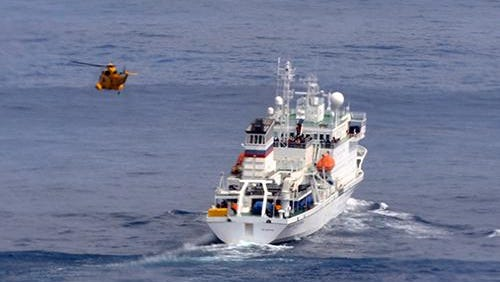 A Royal Air Force helicopter approaches the adventure cruise vessel Akademik Sergey Vavilov during a rescue of a passenger bitten by a seal.