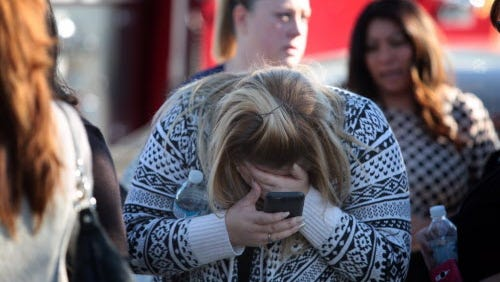 A woman cries at the scene of a mass shooting at the Inland Regional Center in San Bernardino, Calif., on Dec. 2, 2015.